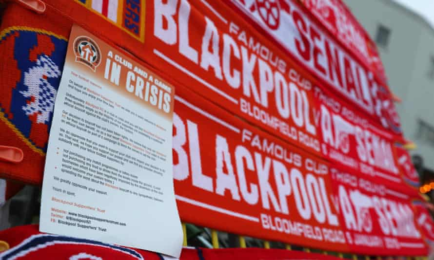 A letter asking Arsenal fans not to buy food and drink at their game with Blackpool, along with half-and-half scarves