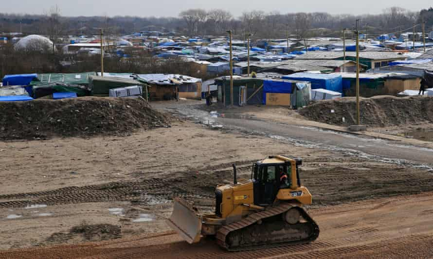 A bulldozer builds a new road in Calais's Jungle.