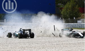 The Mercedes of Lewis Hamilton and Nico Rosberg end up in the gravel after their first-lap coming-together at the Spanish Grand Prix.