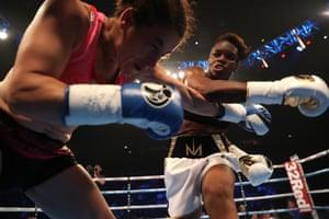 Nicola Adams OBE (R) throws a punch at Virginia Noemi Carcamo