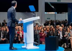 Boris Johnson in the front row in the audience for Rishi Sunak's speech earlier.
