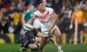 St Helens' Morgan Knowles celebrates scoring his side's first try of the Grand Final against Salford Red Devils at Old Trafford.