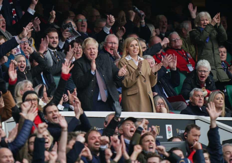 Boris Johnson and his partner, Carrie Symonds, watch England v Wales at Twickenham on 7 March, six days before sport was halted