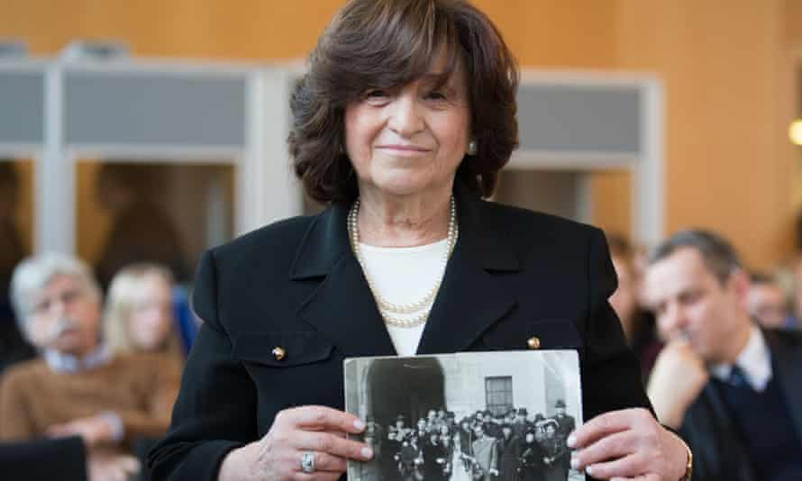 Angela Orosz holds a photo of her parents while attending the trial of former Nazi SS guard Reinhold Hanning in Detmold, Germany.