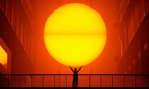 Olafur Eliasson's artifical sun blazes in the Turbine Hall of Tate Modern, 2003.