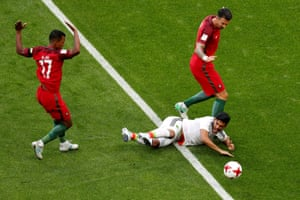 Nani fouls Carlos Vela of Mexico