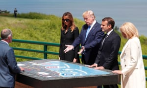 From left: Melania Trump, President Trump, President Macron and Brigitte Macron inspect a map during D-Day celebrations in Normandy.