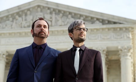 Charlie Craig, left, and David Mullins wait to speak to journalists after the US Supreme Court argued the case Masterpiece Cakeshop v Colorado Civil Rights Commission in December in Washington.