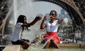 People cool off in Paris as heatwaves continues across Europe.