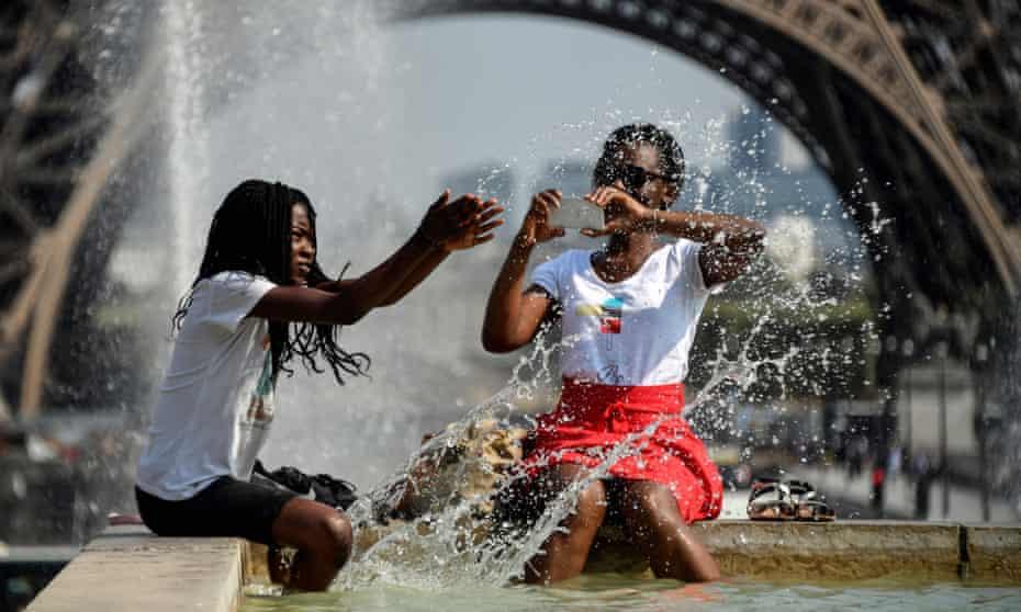 People cool off in Paris as heatwaves continues across Europe.