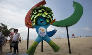 Tom, the mascot of the Rio Paralympics, jumps in front of the sculpture of Agitos, symbol of the Games, on Copacabana beach.
