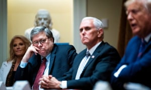 William Barr looks on as Donald Trump makes remarks in the Cabinet Room of the White House.