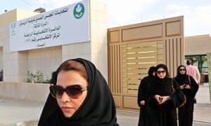 Saudi women leave polling station