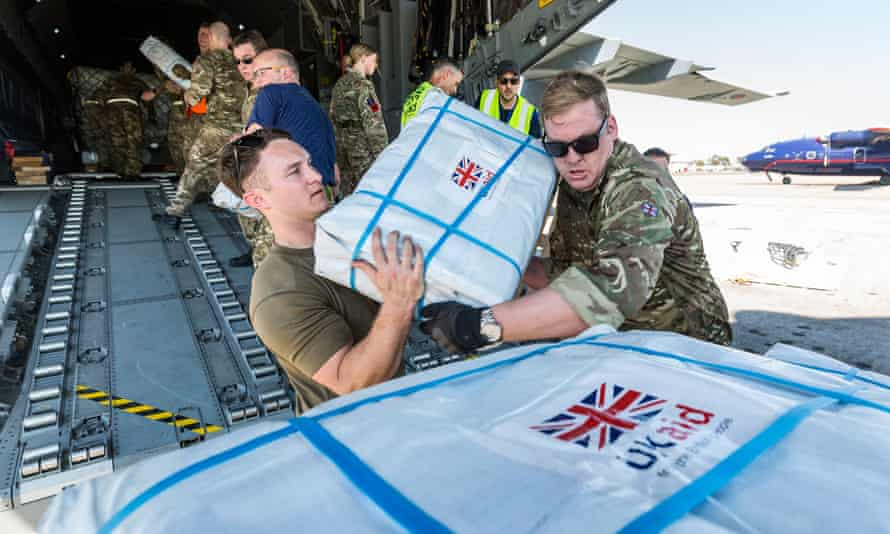 Royal Air Force personnel offloading aid in Mozambique after Cyclone Idai.