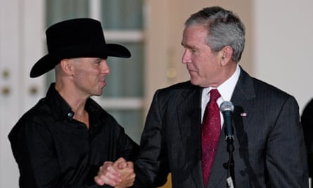 George W Bush shakes hands with country singer Kenny Chesney