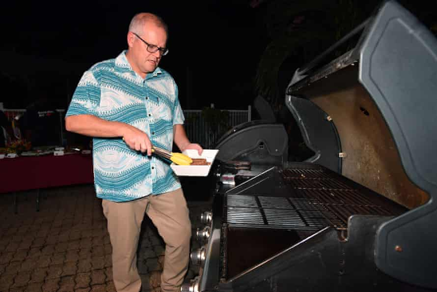 Scott Morrison tends to the barbecue at the home of the Australian high commissioner to the Solomon Islands on Sunday.