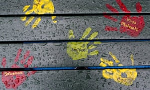 Painted hand prints with names of teachers and students are on a playground bench at the new Sandy Hook elementary school in Newtown, Connecticut, scene of the 2012 shooting.