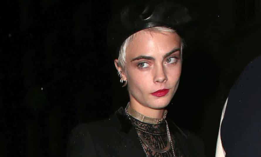 Cara Delevingne arrives at a party during London fashion week