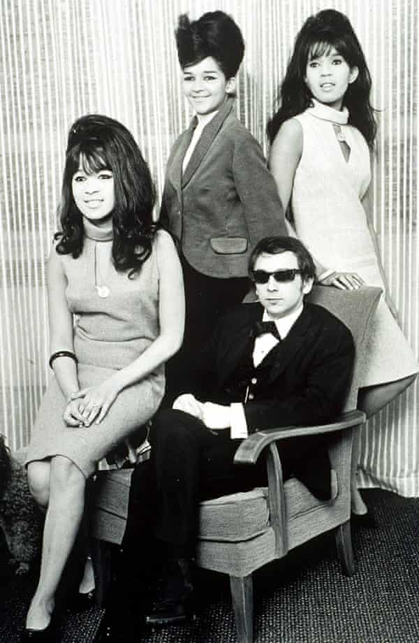 'Give them a tambourine!' . . . Ronnie Spector, sitting on the arm of the chair, was married to Phil Spector, seated, from 1968 to 74.