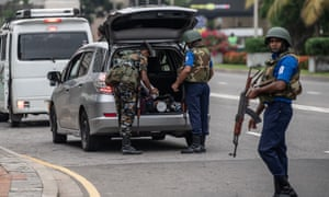 Sri Lankan security personnel search a vehicle in Colombo.