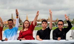Panusaya Sithijirawattanakul raises a three finger salute during a press conference with other pro-democracy supporters last week prior to a planned protest on Wednesday