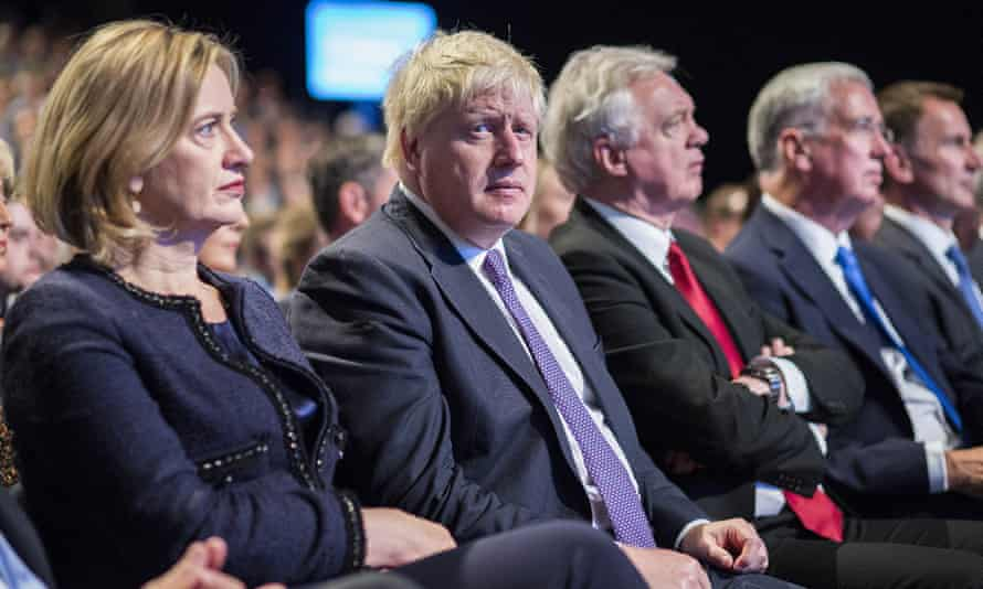 Cabinet members listen as Theresa May delivers her speech at conference