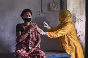 A healthcare worker gives a tetanus injection to a pregnant woman at her clinic on a remote island in Sundarban, West Bengal, India, 2020