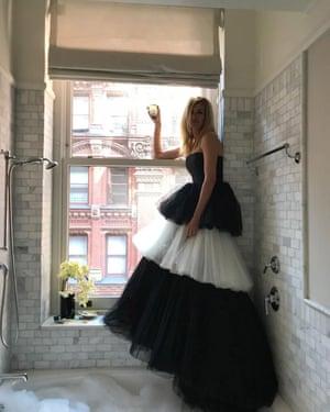 Julia Roberts poses over a full bubble bath