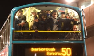 Supporters celebrating the triumph on the bus