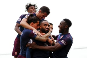 Lacazette celebrates with teammates after scoring his second goal.