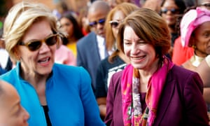 Warren and Amy Klobuchar greet people before marching in the annual Bloody Sunday March across the Edmund Pettus Bridge in Selma, Alabama, on 1 March.