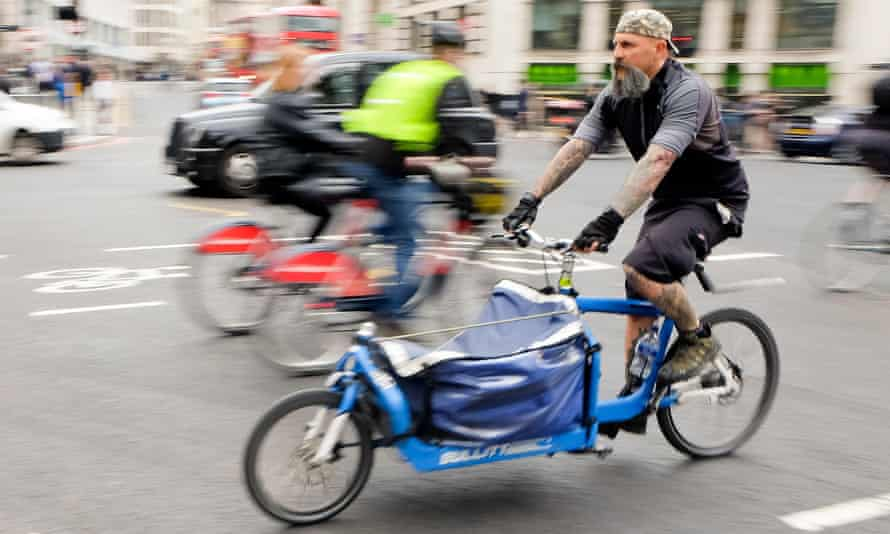 Cyclist on cargo bike in London