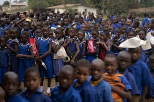 Primary school pupils in Kombayendeh, Sierra Leone, queue to enter their classrooms