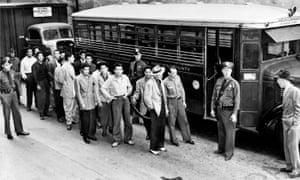 """Men under arrest en route to court during the Los Angeles """"zoot suit riots"""" in June 1943"""