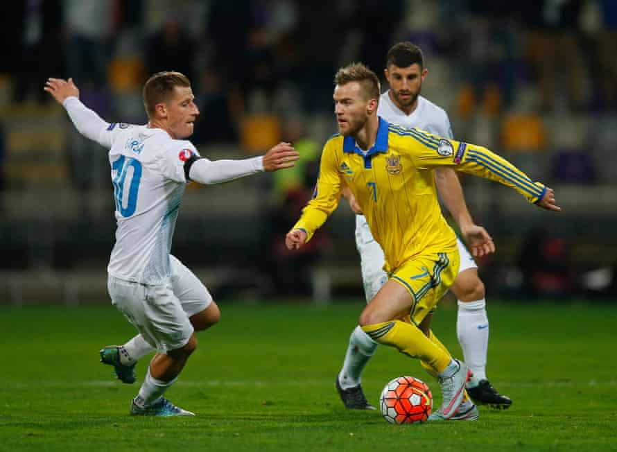 Andriy Yarmolenko of Ukraine goes past Valter Birsa of Slovenia during the Euro 2016 qualifier play-off second leg match.