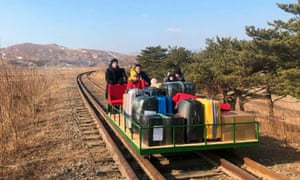 Russian diplomats exit North Korea on trolleys built for evacuating foreigners.