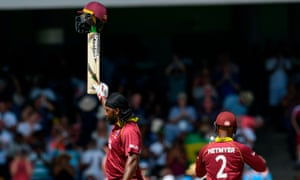 Chris Gayle celebrates his century.
