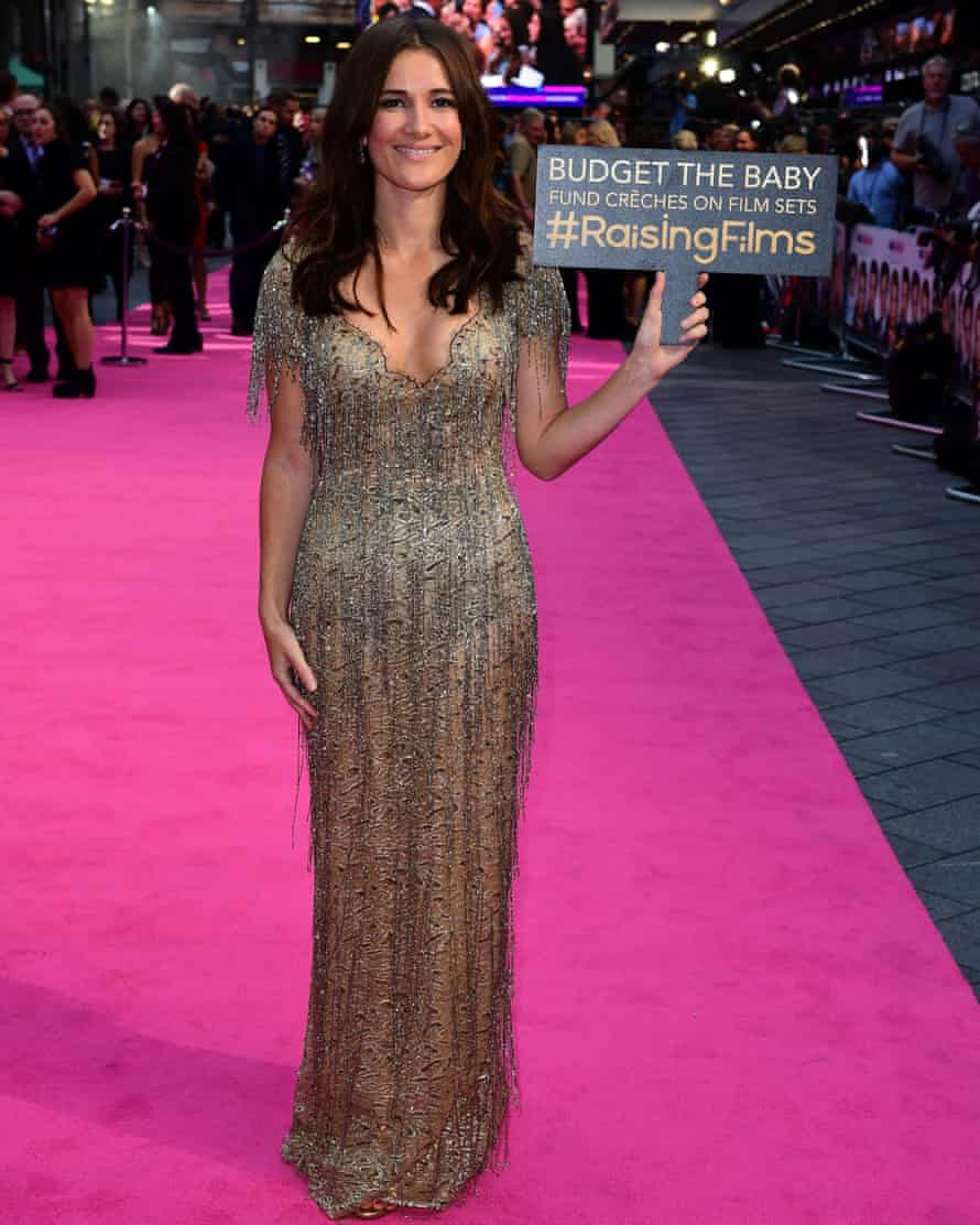 Sarah Solemani holding a placard at the premiere of Bridget Jones's Baby.