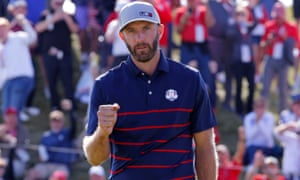 Dustin Johnson reacts after holing his birdie putt on the 11th green to win the hole.