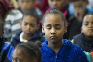 South African children at Rosewood Primary school take part in a free meditation class, in Bonteheuwel, a Cape Town suburb with significant gang problems.