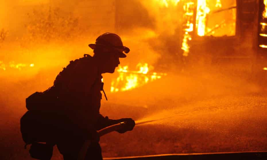 Firefighters try to extinguish the Dixie fire in Greenville, California, on Thursday.