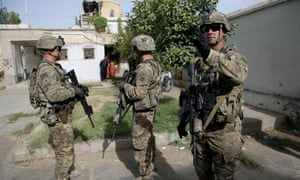 US military forces stand guard during a visit by Kabul's officials in the governor's compound in Kandahar, Afghanistan, on Thursday.