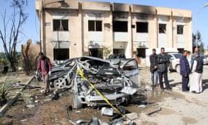 Libyans at the site of the suicide bombing in Zliten.