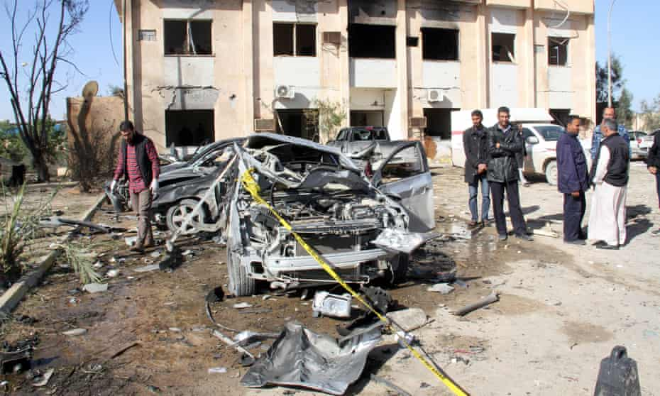 The aftermath of an Islamic State suicide car bomb attack on a military training camp in Zlitan