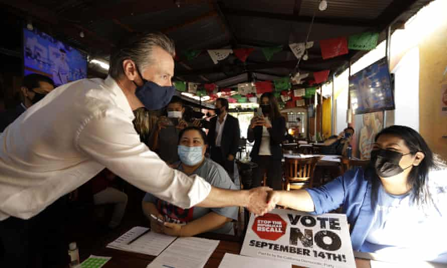 Gavin Newsom greets volunteers who were working the phone banks in support of voting against the governor's recall at Hecho en Mexico restaurant in East Los Angeles.