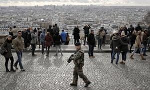 A soldier patrols outside the Sacre Coeur basilica in Montmartre, Paris