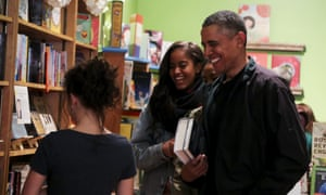 Barack Obama buys books for his daughters Malia and Sasha at Upshur Books Store in Washington.