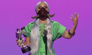 Lady Gaga accepting the award for Song of the Year in a horned mask.