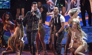 Victor Manuelle, left and Luis Fonsi perform Despacito at the Latin Grammy awards in Las Vegas.