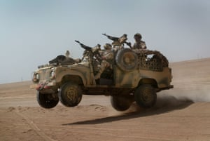 Members of a Brigade Patrol Troop, part of the Brigade Recce Force, who are an elite team within the Marine Commando Brigade, out in the northern Kuwaiti desert in their 'WMIK' Land Rover in 2003
